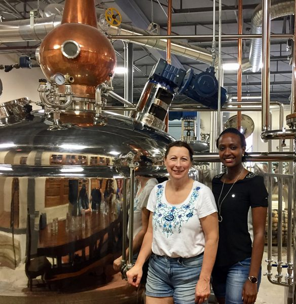 Melinda Lockhart, mentor, with Yvonne Umutoni, visiting a Dallas brewery