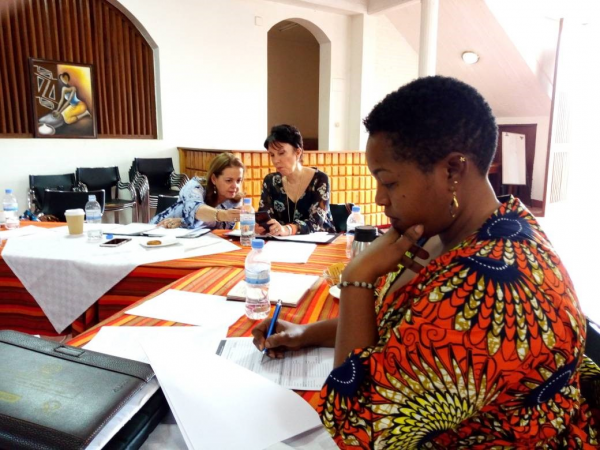 Christine Hategekimana (PTB® class of 2017) hard at work on the PTB® loan committee in Rwanda along with IEEW March 2018 delegation members Nancy Hyde and Mary Blankenship Pointer.