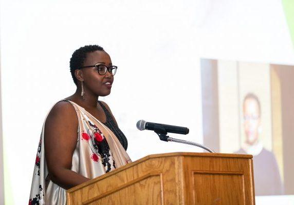 Barbara Umuhoza takes the podium at the 2019 Graduation Gala in Las Colinas, Texas.