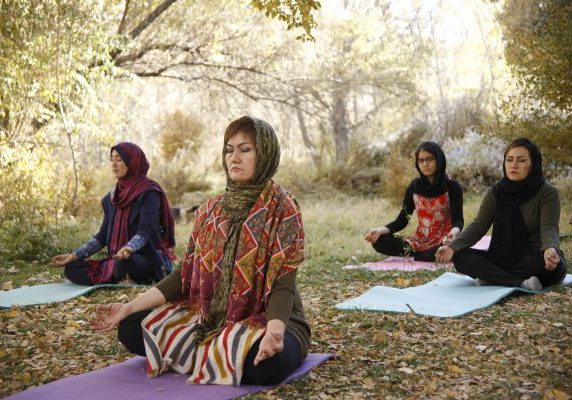 Fakhria Momtaz leads an outdoor yoga class in Afghanistan.
