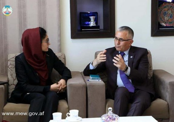 Bibi Yalda speaking with Afghanistan's Minister of Energy and Water, Mr. Mohammad Gul Khulmi.